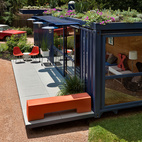 Texas architect Jim Poteet helped Stacey Hill, who lives in a San Antonio artists' community, wrangle an empty steel shipping container into a playhouse, a garden retreat, and a guesthouse for visiting artists. Jon Ahrens of Madrone Landscaping, who layed out the plantings around the container, implemented a green roof on a drip watering system. The cantilevered overhang at rear is planted with cacti. Photo by Chris Cooper.  Photo by Chris Cooper.   This originally appeared in Smaller in Texas.