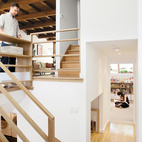 "Architect Christi Azevedo, along with homeowners Lorena Siminovich and Esteban Kerner, transformed this 1,485-square-foot, multilevel, mid-century maze into a modern and efficient family home in just three months. ""It was the craziest frickin' thing,"" laughs Azevedo. ""It was like a Tetris game, putting it all together, trying to squeak out space wherever we could."" Purchased as if straight out of 1955, the home is now the ideal small space for Siminovich and Kerner to raise their young daughter, Matilda.  Photo by: Daniel HennessyCourtesy of: ©2011 DANIEL HENNESSY PHOTOGRAPHY, LLC"