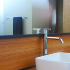 Eco-friendly features include on-demand hot water, dual flush toilets and low flow faucets in the sinks and shower/tub.