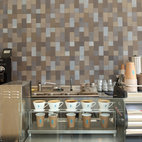 """The cafe's accent wall features 4"""" x 4"""" and 4"""" x 8"""" tiles in a stitch pattern, with a mix of glazes: Shade, Shade light, Slate #2, Shark, and Blue Lake.  Courtesy of 2012, Clay McLachlan."""