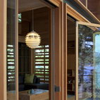 Here's a shot looking back toward the reading area through the glass wall system. The steel moment frame is trimmed with the reclaimed T&G wood. The doors fold away to open the entire addition to the large deck overlooking Henry Point and the lake.
