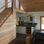"""""""We opened the space up to light as much as possible and made the kitchen the pivot or control center of the place,"""" says Flowers. """"It's where most of the action happens outside of being down at the lake."""""""