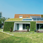 The E+ Green Home, a concept house located an hour outside Seoul, not only points the way to a greener South Korea, it may well be the most sustainable house in the country.  Read more: http://www.dwell.com/slideshows/E-for-Effort.html?slide=1&c=y&paused=true#ixzz26xvWPsS7  Photo by Sergio Pirrone.   This originally appeared in Modern Green Concept House in South Korea.