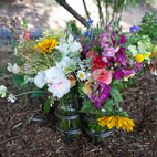 The fruits of their labors: beautiful cut flowers, which Silverlake Farms sells at local farmers' markets in signature iron-and-glass jars.  Photo by: Catherine Ledner