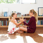 Daughters Ingrid and Jane play on the floor of their bedroom, laid with reclaimed end-grain parquet from Oregon Lumber.  Photo by: Catherine Ledner