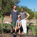 """Gabbert and Avery pose with Ingrid in their """"growing ground,"""" planted and tended by local urban farmer Tara Kolla and a fleet of volunteers.  Photo by: Catherine Ledner"""