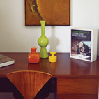 Tucked into one end of the house, a desk by Florence Knoll displays Stacey's mid-century pottery.  Photo by: JUCO