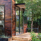 In addition to charred wood siding—shown here in the cherry stain—Sett Studio can also add decking and landscaping.  Courtesy of: blake gordon photography