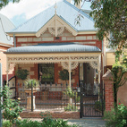 Brammy and Kyprianou hardly touched the front of their house, an 1880 sandstone and brick Victorian with galvanized iron ornamentation.  Photo by: James KnowlerCourtesy of: James Knowler Photography