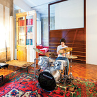 In one area of the apartment, Tagliabue's son, Domenec, plays drums in front of a sliding wood panel of the architects' design.  Photo by: Gunnar KnechtelCourtesy of: Gunnar Knechtel