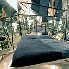 "One of the original Propeller Island rooms, the Mirror Room is designed to make you feel as though you are inside a kaleidoscope. The room comes with an unusual tagline, ""Warning: very sexy."""