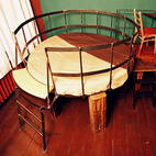 "Although you can't be over six feet tall to stay in this room, it is the most traditionally appealing. The bed and desk are built on top of a rustic ""table,"" but otherwise everything is right side up and won't trigger a panic attack.For more information about the hotel, visit propeller-island.de."