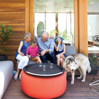Daughters Ingrid and Jane catch up with their grandparents on the Room & Board–furnished front deck.  Photo by: Catherine Ledner
