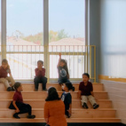 Part of this flexibility is a redefining of the idea of the classroom and other places where students congregate for learning. At PS 861, the Staten Island school of Civic Leadership, students assemble for class on steps in a more open environment. Building designed by Mitchell/Giurgola Architects. Photo by ©Jeff Goldberg/Esto.  Courtesy of © Jeff Goldberg/Esto.