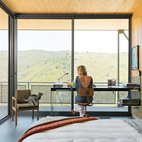 MALIBU CANYON HOUSE WITH A VIEW Working with a limited footprint, a daunting slope, and killer views, architect Bruce Bolander went vertical with a secluded canyon house in Malibu. He designed the custom steel desk as well as the bedside table, fashioned from a speaker tower base and a slab of white oak. Photo by J Bennett Fitts.  Photo by J Bennett Fitts.   This originally appeared in Malibu Canyon House with a View.