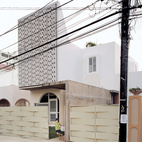 Perforated concrete panels make for a creative curtain facade on the street-facing upper wall of Casa Delpin in San Juan, Puerto Rico.  Photo by Raimund Koch.   This originally appeared in San Juan, PR.