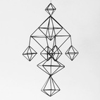 Modeled after Finnish Christmas tradition, this delicate mobile and its geometric design adds a modern feel to any nursery. ($79)