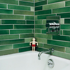 The Heath tiles in the bathroom were hand-selected from boxes of factory seconds.  Photo by John Clark.