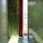 The tiny budget still allowed room for some strategic splurges, such as the vivid green Verde Ming marble in the house's only bathroom.