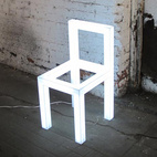 """Holey Chair by Takeshi Miyakawa ($800.00 for one)text """"TMHoleyChair"""" to 767825 (portal)    """"This piece was designed and constructed by Brooklyn-based design-guru Takeshi Miyakawa.  Takeshi, along with architect Vram Malek, built the Subports' car-top store for our feature in Dwell Magazine.  We often refer to Takeshi as Yoda.  He never stresses out, and we have yet to see him measure anything which is mind blowing because everything he makes is absolute perfection.  The 'holey chair' is an LED-powered light fixture, constructed from white acrylic realized in the shape of a chair frame.  It can be placed on the floor or installed on the wall as the owner sees fit."""""""