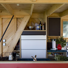 The Sunfrost refrigerator nearly disappears into the simple kitchen.
