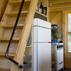 Howell was creative in his space-saving techniques as well as for practical matters. The handrail for the stairs to the loft was pieced together with lengths of PVC pipe and plumbing hardware.