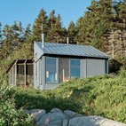 Alex devised a system that takes advantage of ocean views while protecting the cottage from that same northeasterly orientation. The large windows and doors can be shuttered with corrugated aluminum panels.