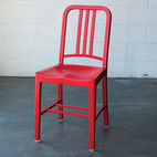 """The original Emeco Navy 1006 (pronounced """"ten oh six"""") chair caught the attention of famous modernist architects including Frank Gehry and Norman Foster. Knock-offs can be found worldwide but the authenticity of the Emeco chair is easily verified by finding indentions on the backside of the chair. Today, the company still manufactures the same 77-step design with recycled Coca-Cola bottles. Photo by Armando Bellmas."""