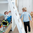 For now, Kimi, age six, and Darin, age two and a half, happily share a room and bunk bed. Kimi's clothes are stored on low shelves in the built-in closet, so he can dress himself, and the children's toys are stored within easy reach in open drawers.