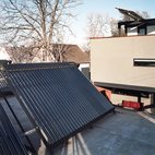 """An array of solar thermal tubes crowns the garage, and photovoltaic panels extend like wings over the third-floor deck. """"If we were going to make a big architectural move, we had to have reasons,"""" Moore explains, referring to the conspicuous placement of the panels."""