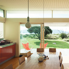 Architect Gerald Parsonson  designed his New Zealand beach house to best take advantage of the site rather than strictly capitalize on views. The combined open-plan kitchen, living, and dining area opens on to the beach with sliding doors that add ease and ventilation. Photo by Matthew Williams  Photo by: Matthew WilliamsCourtesy of: matthew williams