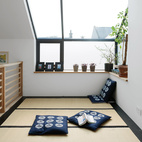 "The tatami room (pictured) has mats from the Futon Company and a ""Hinamatsuri"" mobile adds a cheery touch.  Photo by: Ben Anders"