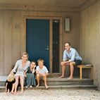 When the Fisher family's 1960s Long Island beach bungalow started to crumble, they sought an architect who'd preserve the home's humble roots and mellow vibe, while subtly bringing the place up to date. The color of the Fishers' front door was inspired by an old Land Rover Defender's hue, which Charlie had Benjamin Moore custom-match. Photo by Richard Foulser.   Photo by: Richard Foulser