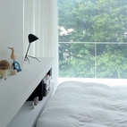 The bedroom has a view of the cherry trees.  Photo by: Takashi Homma