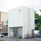 The structure is an elegant riff on the boxy apartments and school that surround it.  Photo by: Takashi Homma