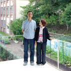 Without a garden of their own, Takuya and Yurika enjoy the verdant view of the schoolyard cherry trees next door from their bedroom balcony.  Photo by: Takashi Homma