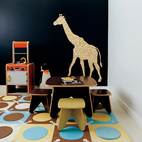 A deeply saturated blue hue colors the playroom wall.  Photo by John Clark.