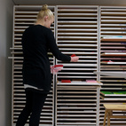 Next, the screens are made, and the designer chooses the color tones. In a room next to the printing machines, a locker with narrow drawers holds numerous pieces of neatly stacked, colorful fabrics.  Courtesy of 2011.