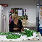 Workers in the on-site sewing area prepare textiles to become linens, bags, and more.  Courtesy of 2011.