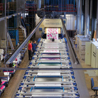 The Marimekko factory prints nearly 6,500 yards of fabric each day. The company typically purchases its material, usually cotton, in 2,200- to 5,500-yard rolls or pallets from Germany, Peru, Turkey, and the Baltic nations. Flat screen–printing makes it possible to divide repeats in sections and create large-size patterns, from 24 inches to several yards long.  Courtesy of 2011                                                  .