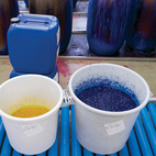 """The inks are stored in plastic wrap–covered buckets, which prevents a thick, top layer from forming. Each day, the color kitchen prepares hundreds of pounds of ink for the hues needed for the following day's printing. """"Thanks to having our own facilities, we can react quickly to sales,"""" Salmi says.  Courtesy of 2011                                                  ."""