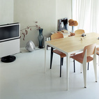 Architect Makoto Tanijiri's firm custom-designed most of the furniture in the building, including the steel-and-paulownia dining table.  Photo by: Takashi Homma