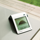 """In the kitchen, an SMA Sunny Beam solar monitor displays the number of kilowatts generated. Though the monitor doesn't display real-time energy consumption, the family often operates in the negative. """"It helps us understand what's going on and seeing it reminds us to be energy-conscious,"""" David says."""