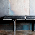 An aluminum bench harmonizes with the industrial nature of the galvanized-steel walls and the polished concrete floor.  Courtesy of Nancy Alonzo.