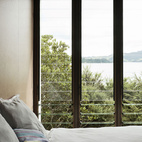 Living so near the water the views, especially through these louvered windows, out to Maramaratotara Bay are spectacular.  Photo by: Matthew WilliamsCourtesy of: matthew williams
