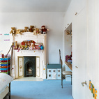 With its modernized Victorian elements, this home in Richmond, England, has the whimsy of a doll house as well as a genteel, contemporary feel. By leaving the kid's bedroom as a mutable space, artist Judith Brenner gave a flexible personality to playtime. Photo by: Richard Powers.  Photo by: Richard Powers