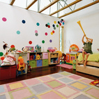 Walls spotted with fabric polka dots welcome play in this home just outside of Milwaukee, Wisconsin. By prioritizing space for work and play in their renovation, the Edstroms teach their children that work can also be play. Photo by: Cameron Wittig.  Photo by: Cameron Wittig