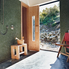 Queenstown gets cold in winter, hence the installation of a sauna. Outside, the landscaping was kept deliberately casual, with rock walls and gravel paths.