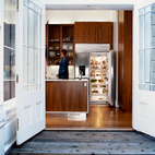 The walnut cabinets in the kitchen, which update and warm the space, were designed by Nilus de Matran and fabricated by George Slack.  Photo by: Dave Lauridsen