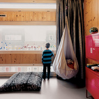 Finn's street-facing room at the front of the house is enlivened by varying window sizes.